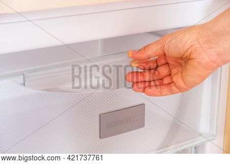 Tambov, Russian Federation - April 15, 2021 A Woman's Hand Taking A Compartment Out Of A Liebherr Fr