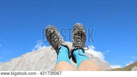 Two Trekking Shoes During The Rest Of The Walker In The Mountains