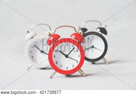 Outstanding Red Analog Alarm Clock With Blurred Black And White On Grunge Grey Background, Leading P