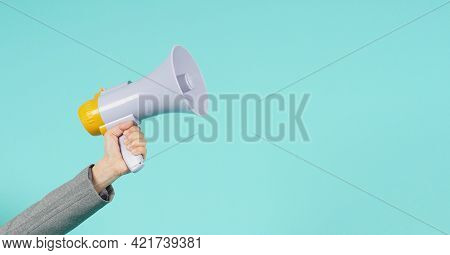 Hand Is Hold Megaphone And Wear Grey Suit On Green Or Mint Or Tiffany Blue  Background.