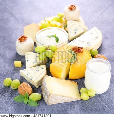 assorted of dairy products on wooden board
