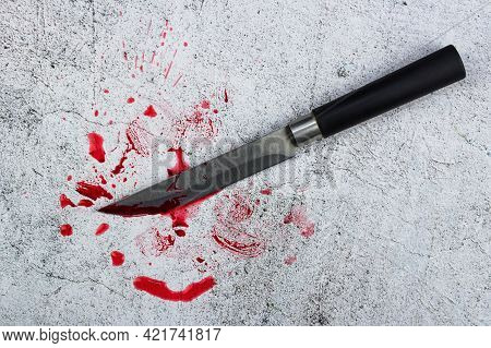 Kitchen Knife And Blood. A Tool Or A Murder Weapon?kitchen Knife On A Concrete Background And Blood