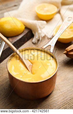 Delicious Lemon Curd In Saucepan On Wooden Table