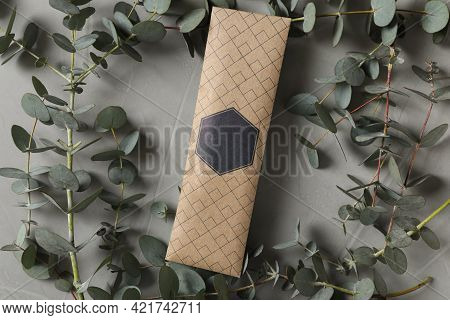 Scented Sachet And Eucalyptus Branches On Grey Table, Flat Lay