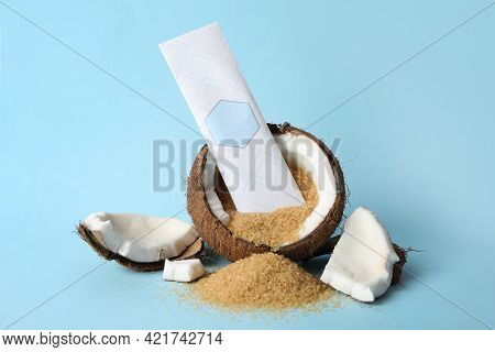 Scented Sachet, Coconut And Brown Sugar On Light Blue Background