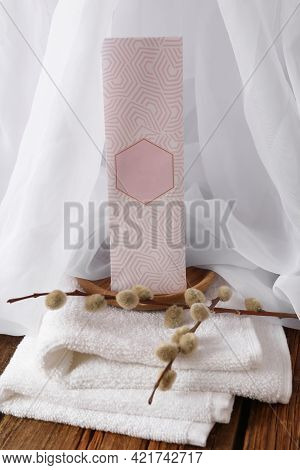 Scented Sachet, Pussy Willow Branches And Towel On Wooden Table