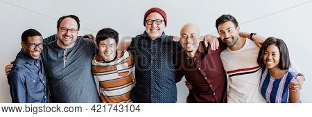 Cheerful diverse people embracing each other