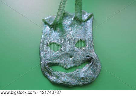 Terrible  Slime Face. Halloween Autumn Holiday Concept. Textured  Green  Slime With Glitter Inside.