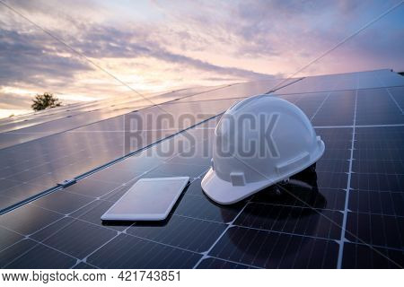 Helmet With Tablet On The Solar Panel For Working Solar Station Photovoltaic Panels, Science Solar E