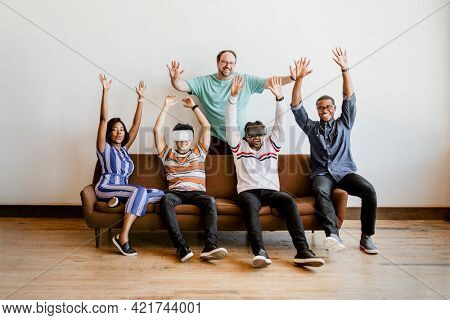 Group of diverse friends experiencing virtual reality with VR headset