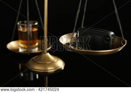 Scales Of Justice With Car Key And Alcohol On Black Background, Closeup. Drunk Driving