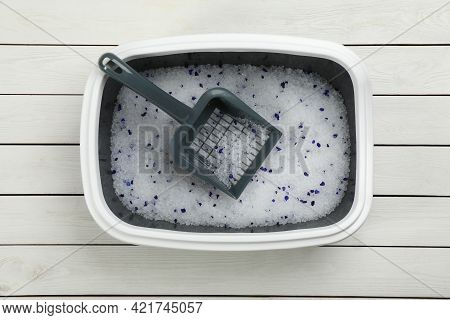 Cat Litter Tray With Filler And Scoop On White Wooden Floor, Top View