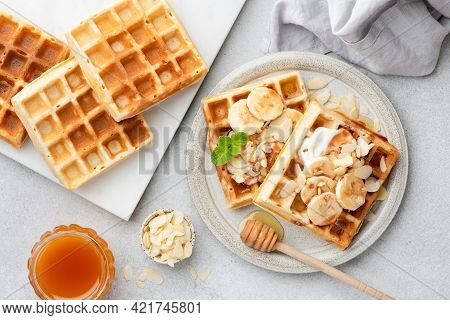 Breakfast Belgian Waffles With Banana, Yogurt And Almonds