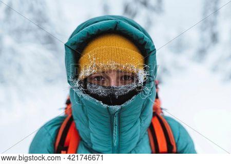 Female mountaineer in wintertime at Glen Coe, Scotland