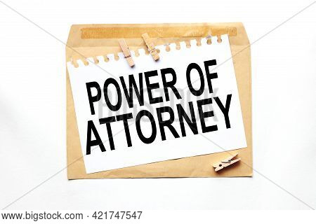 Power Of Attorney. Text On White Paper On Craft Notebook