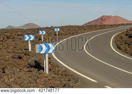 Rural Road On Lava With Street Signals At Lanzarote Island, Spain