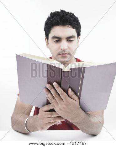 Asian Male Of Indian Origin Reading A Book