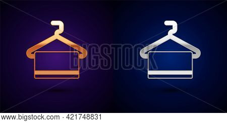 Gold And Silver Towel On Hanger Icon Isolated On Black Background. Bathroom Towel Icon. Vector