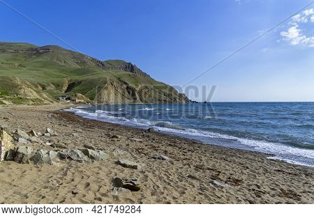 An Empty Sandy Beach In Kapsel Bay At The Foot Of Cape Meganom. Off-season. Crimea, End Of April.
