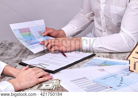 Businesspeople Discussing Statistic Graphs. Statistic Charts Before Signing Contract.
