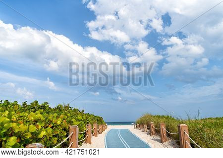 Pathway To Miami Beach In Florida, Usa. South Beach Access On Sky Background