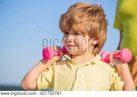 Sporty Boy With Dumbbells. Cheerful Boy Do Exercises With Dumbbells. Kid Exercising With Dumbbells.