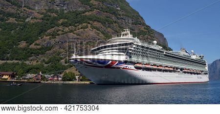 Panoramic - marine of famous Flam . Tourism vacation and travel. Mountains landscape and big cruise ship on fjord Sognefjord.June 17,2018. Flam Norway Scandinavia.