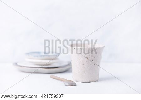 Traditional, Handcrafted Ceramic On Bright Wooden Background. Soft Focus. Close Up. Copy Space.