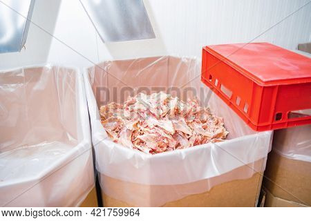 Chicken Feet, Chicken Feet That Are Cut Into Many Pieces In A Large Box.line For The Production Of M