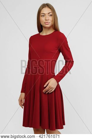 Gorgeous Woman. Portrait Of Beautiful Smiling Young Woman Standing In Cute Red Dress Isolated On Whi