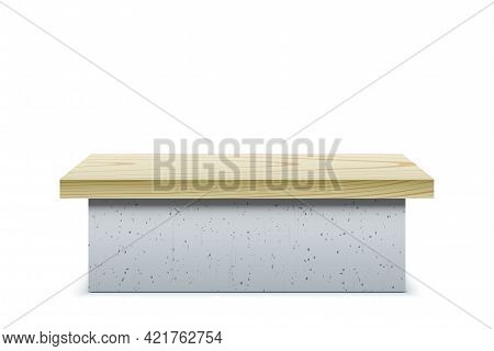 A Wide Concrete Bench With Wooden Cover.
