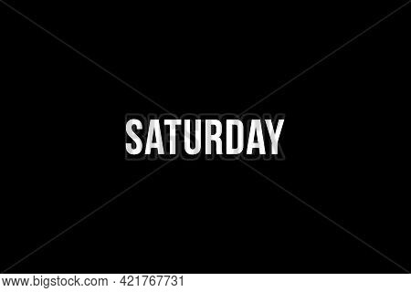Saturday. Day Of The Week. Weekly Calendar Day. White Letters Word Saturday On Black Background, Pos
