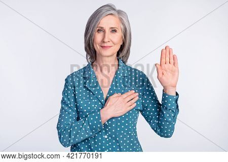 Portrait Of Attractive Sincere Middle-aged Lady Saying Oath Praying Isolated Over Gray Light Pastel
