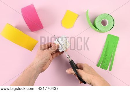 Kinesiology Taping. Woman Cuts The Pink Tapes And Make Shape Of Lantern. Body Correction Of Lymph Ou