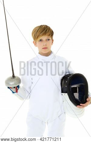 Boy In Fencing Costume Posing With Sabre And Mask