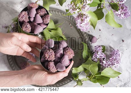 Belgian Sweets Cuberdon And Pralines In Silver Glasses, Spring Still Life With Lilac Flowers, Flat L