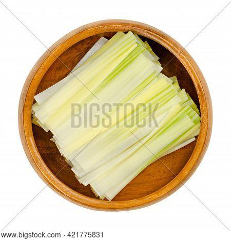 Leek Strips, In A Wooden Bowl. Leeks Julienne, Leek Leaves Cut Into Strips. Allium Ampeloprasum, A C