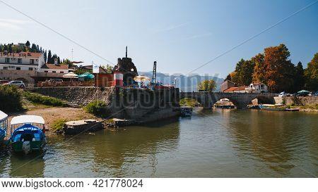 Montenegro, National Park Skadar Lake - September, 21 2018: A Bridge In Virpazar Village And Small B