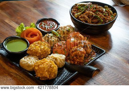 Fusion Of Indian Nepali Tibetan Chinese Cooking Of Fried Tandoori Roasted Grilled Momos With Sauces