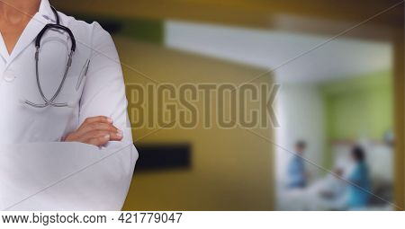 Doctor wearing white blouse and stetoscop with couple having baby. hospital background concept. digitally generated image