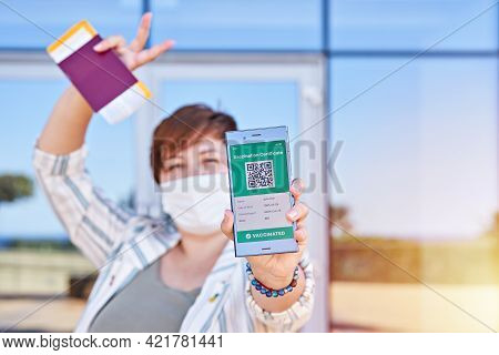 Happy Woman Holding Smartphone Displaying On App Mobile Valid Digital Vaccination Certificate For Co