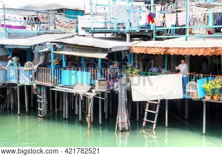Hong Kong-apr. 10, 2011: Residents Of Tai O Fishing From Their Houses On Stilts Above The Tidal Flat