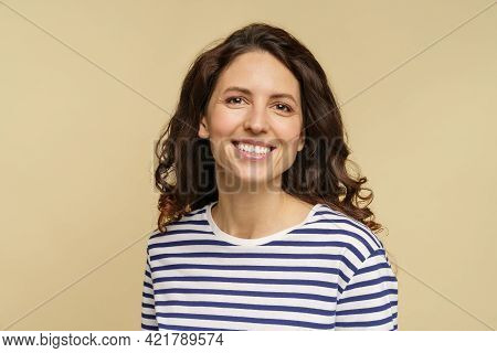 Portrait Of Curly Caucasian Female, Closeup Studio Shot Over Beige Background. Millennial Woman With