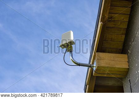 Antenna Amplifier For Home Mobile Internet Attached To A Wooden Roof Truss.