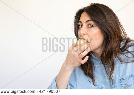 Pretty Woman Eating A Piece Of Cake:copy Space.isolated On White Background