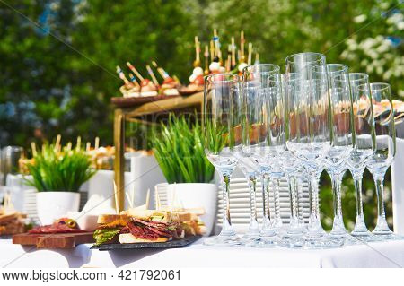 Glasses, Canapes And Cold Snacks On The Table While Waiting For The Start Of The Buffet In The Open