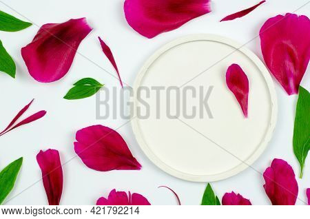 Round Podium For Presentation Of Products On A White Background With Pink Petals And Baked Leaves. S