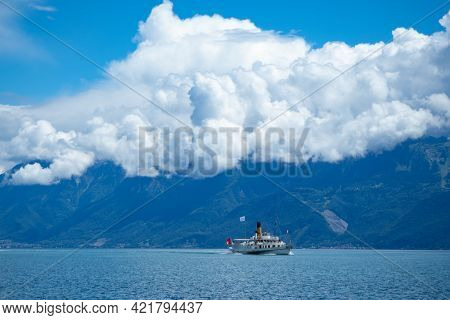 One Of The Famous Paddle Steamers On Lac Leman In Front Of The Mountains