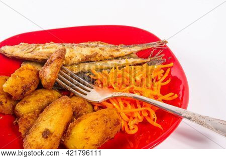 Homemade Dish - Fried Potato Wedges With Small Fish And Pickled Carrots On A Red Plate, Simple Rusti