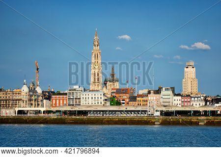 View of Antwerp over the River Scheldt with Cathedral of Our Lady Onze-Lieve-Vrouwekathedraal Antwerpen, Belgium.